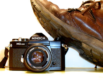 A boot stamping on a camera... forever. Yes, I know this is an SLR. But I was using the digital camera to take the photo!